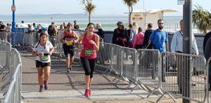 Me running the Bournemouth marathon towards Bournemouth Pier