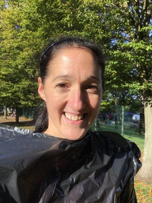 girl wearing black bin bag in park waiting to start a running race