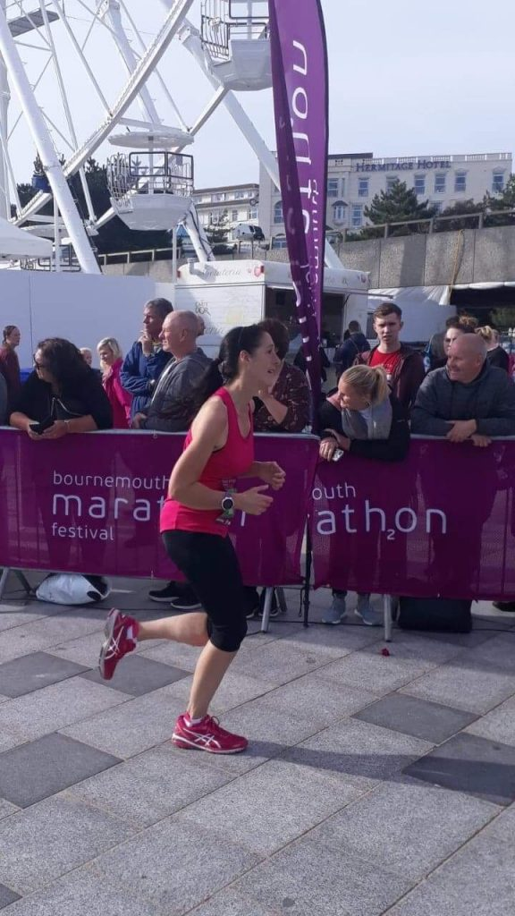 Sara looking tired as she is finishing the bournemouth marathon