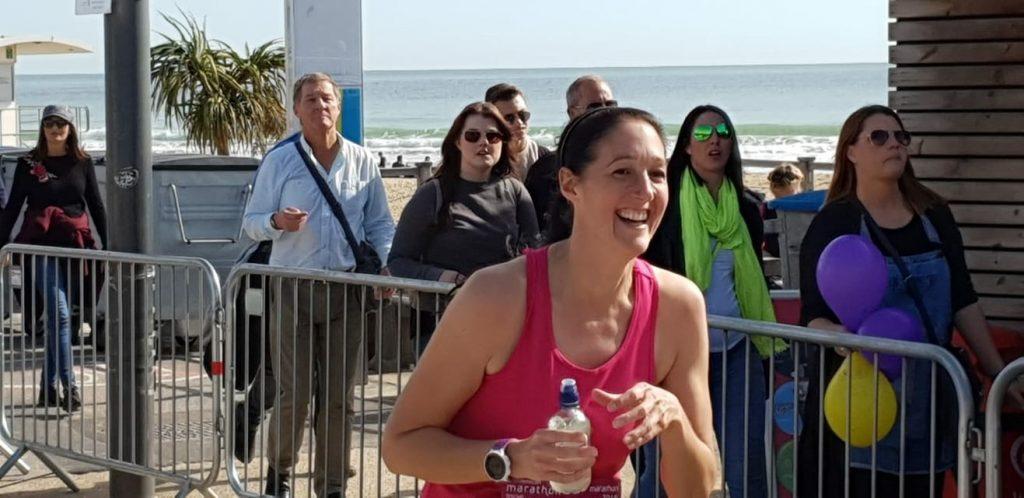 Sara laughing as she is running the bournemouth marathon