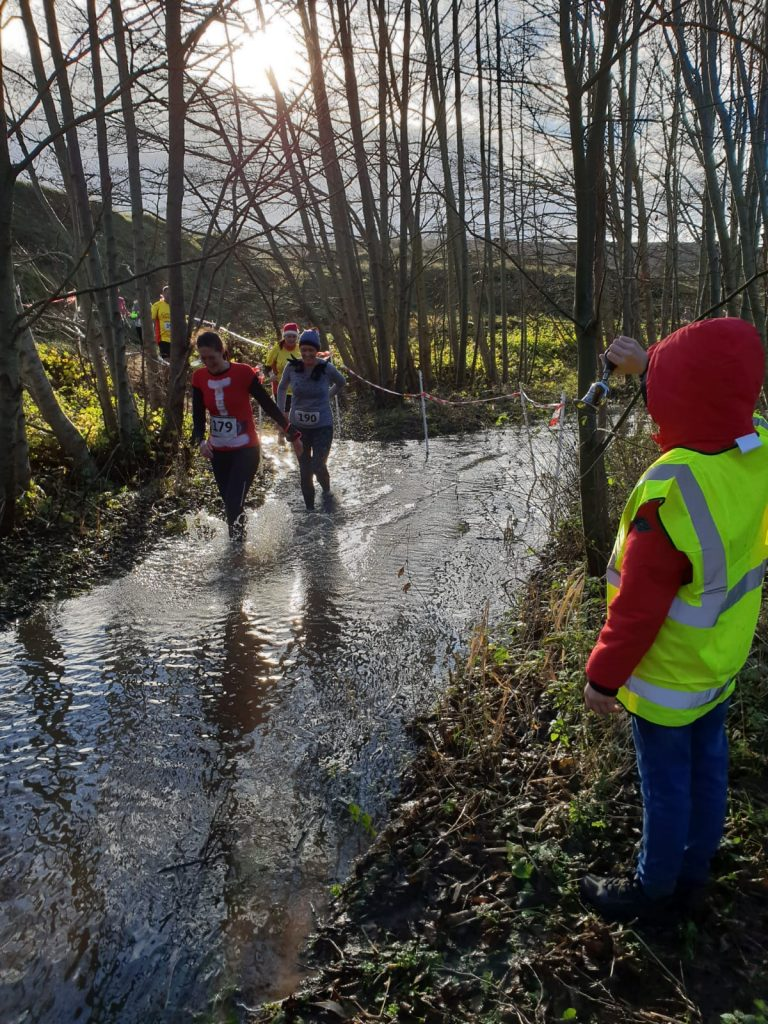 Me and Rhian going through more water at the Merthyr Mawr Christmas Pudding Race