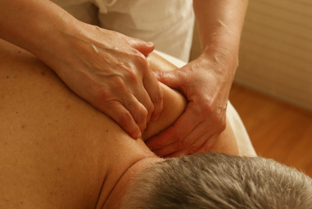 Man having sports massage on his left shoulder