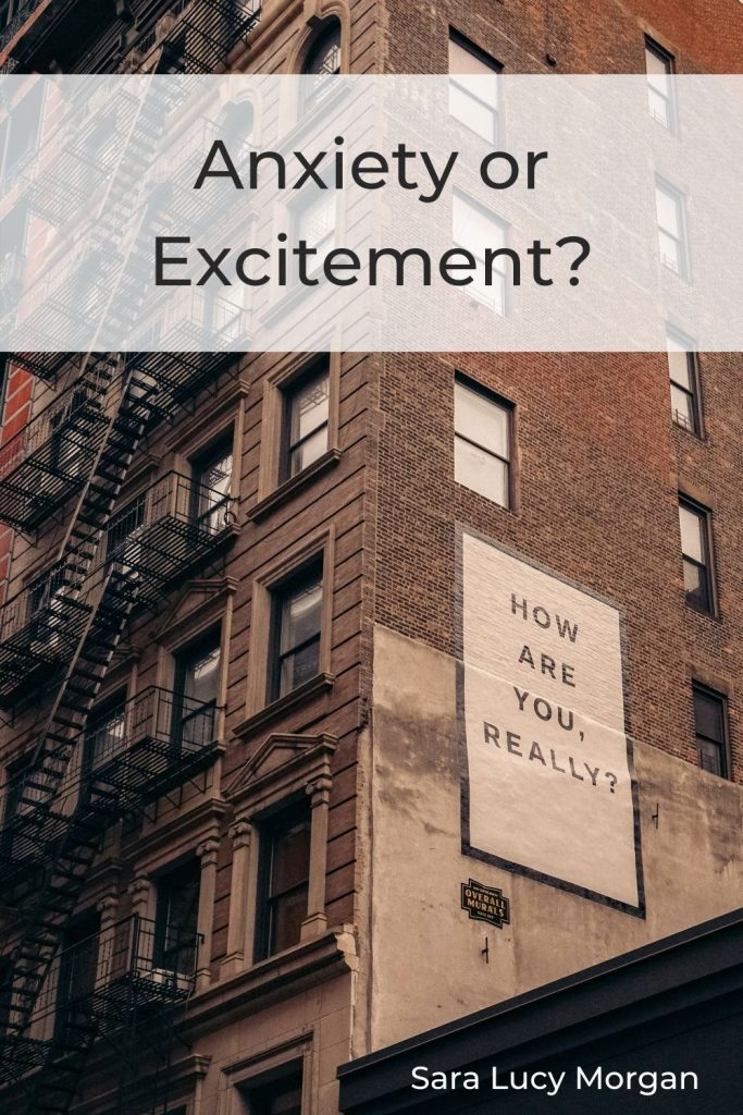 "Anxiety or excitement - building with a billboard poster asking ""How are you really?"""