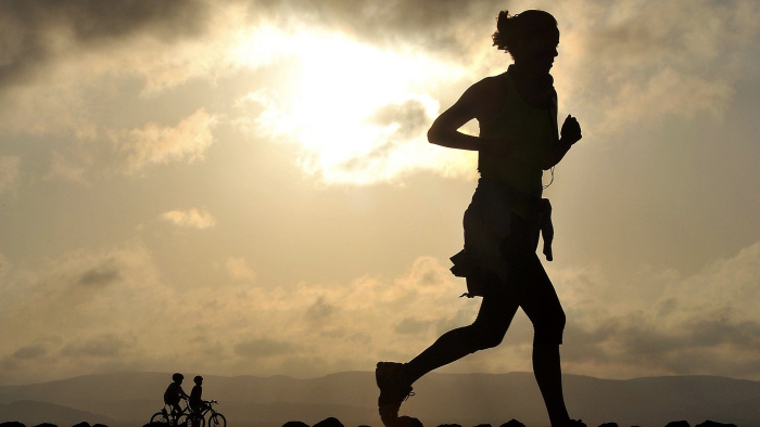 Running is hard - silhouette of a woman running.