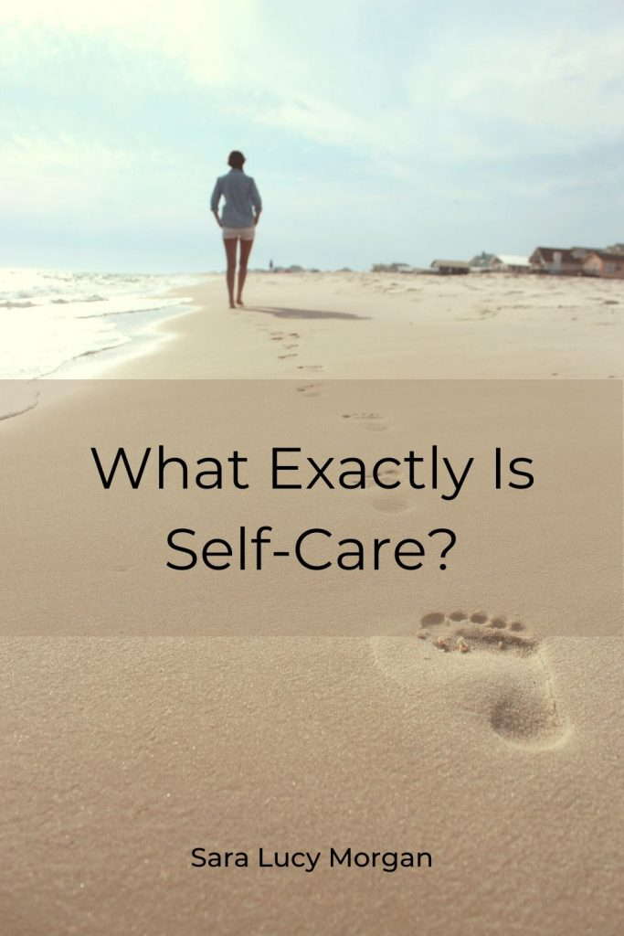 What exactly is self-care - person walking along the beach leaving footprints in the sand